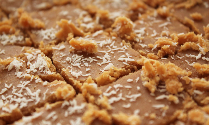 Up close shot of Vegan Coconut Fudge after it was just sliced into squares.