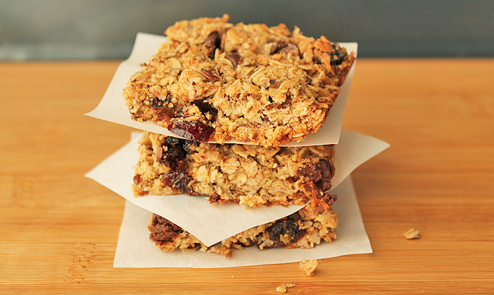 Up close shot of three Granola Squares that are stacked on top of each other.