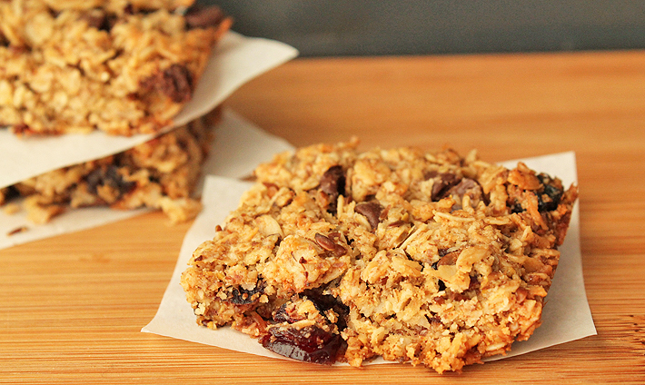 Granola Squares sitting on a wood cutting board.