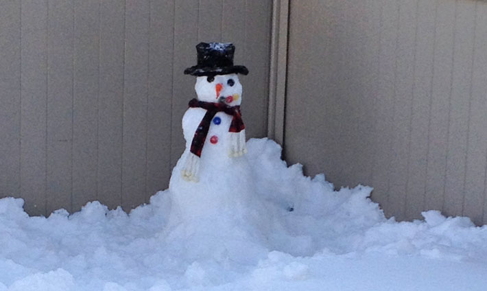A snowman that was built just before enjoying a cup of Creamy Vegan Hot Chocolate.