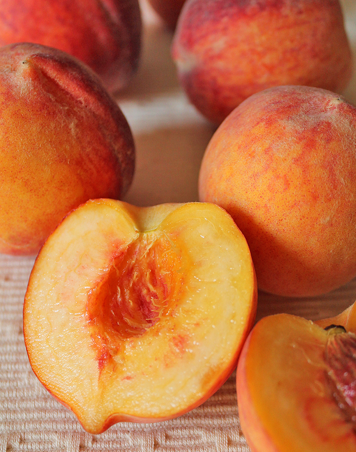 Take advantage of these juicy seasonal peaches by making this sweet, tart, delicious Coconut Peach Ice Cream!
