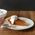 Vanilla bean coconut whipped cream topping on a slice of pumpkin pie.