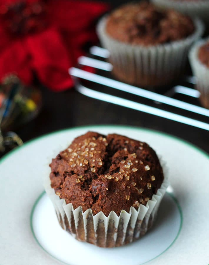 Vegan Gluten Free Gingerbread Chocolate Chip Muffins on a white plate.