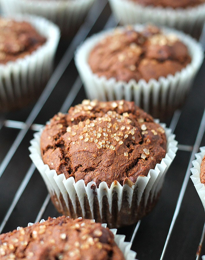 Vegan Gluten Free Gingerbread Chocolate Chip Muffins sitting on a stainless steel cooling rack.