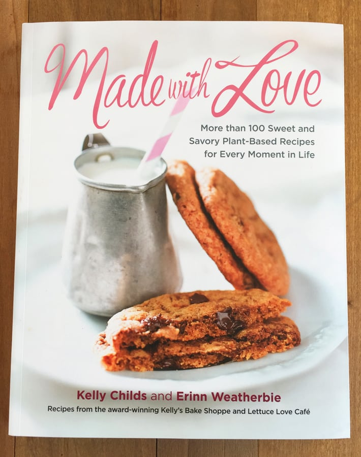 Picture of the Made with Love Book that contains the vegan gluten free bite size brownies recipe found in this post.