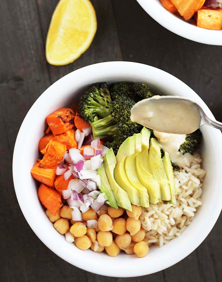 The garlic tahini sauce that tops these Sweet Potato Broccoli Chickpea Bowls is what makes this dish extra special.