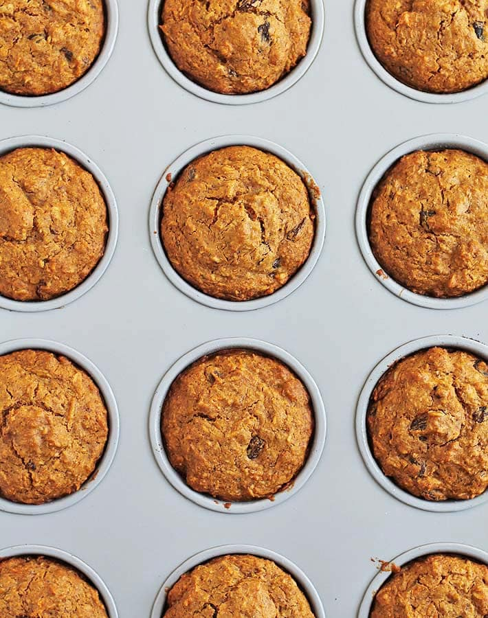 Carrot Coconut Muffins in a muffin pan just out of the oven.