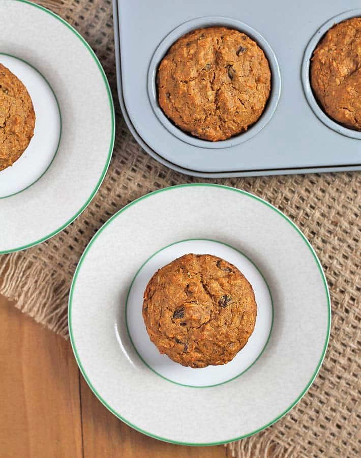 Overhead shot of carrot coconut muffins on a table.