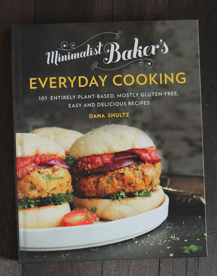 A shot of the cover of the Minimalist Baker's Everyday Cooking cookbook that contains the recipe for vegan breakfast burrito.
