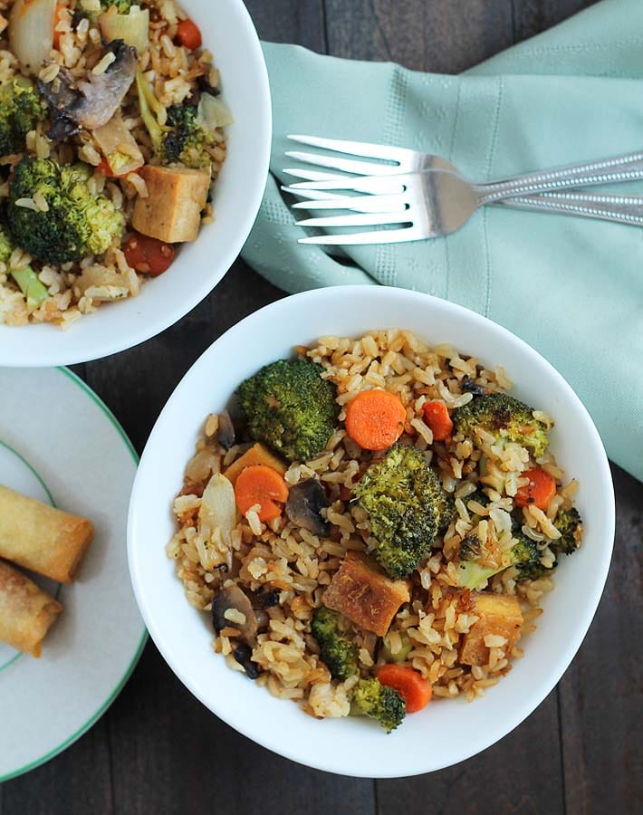 Looking for a quick weeknight dinner idea? This vegan Vegetable Fried Rice with Crispy Ginger Garlic Tofu is perfect, and you'll have leftovers for lunches.
