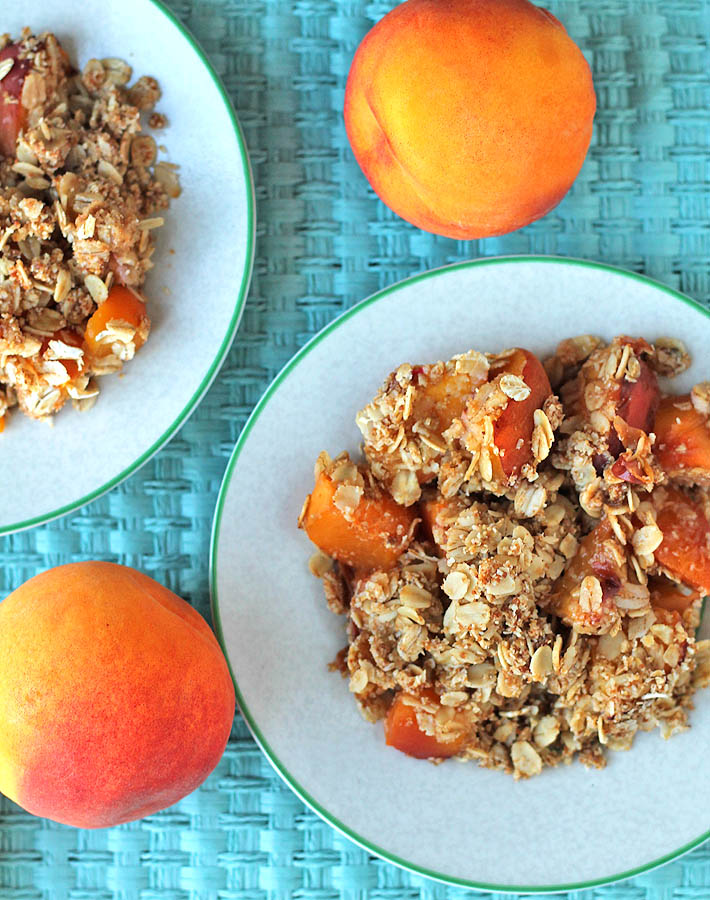 This gluten free Vegan Peach Ginger Crisp makes great use of sweet summer peaches. An easy, delicious, and not overly-sweet dessert to serve to guests!
