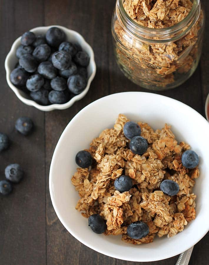 Overhead shot of a bowl of nut free granola and blueberries.