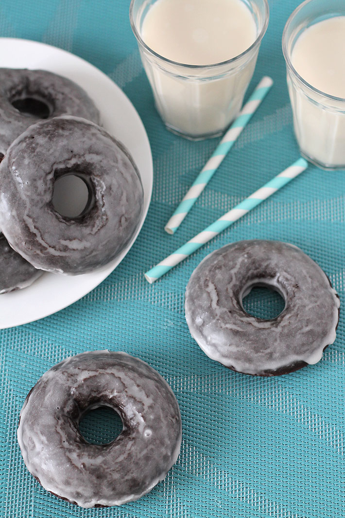 Looking for Vegan Gluten Free Baked Chocolate Doughnuts? Your search has ended. This recipe can be made vegan OR vegan and gluten free and the result is perfectly soft, chocolaty, sweet doughnuts you'll love! #vegandoughnuts #veganglutenfree #glutenfreevegan #glutenfreedoughnuts #vegandonuts #glutenfreedonuts