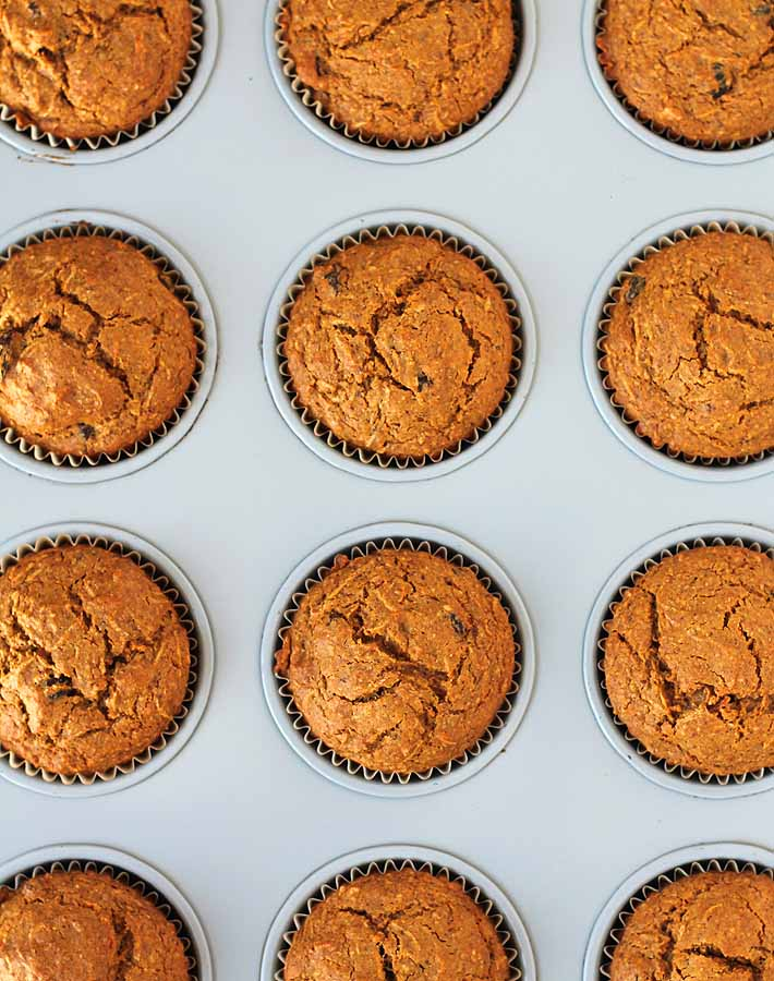 Overhead shot of Carrot Ginger Muffins in a muffin tin.