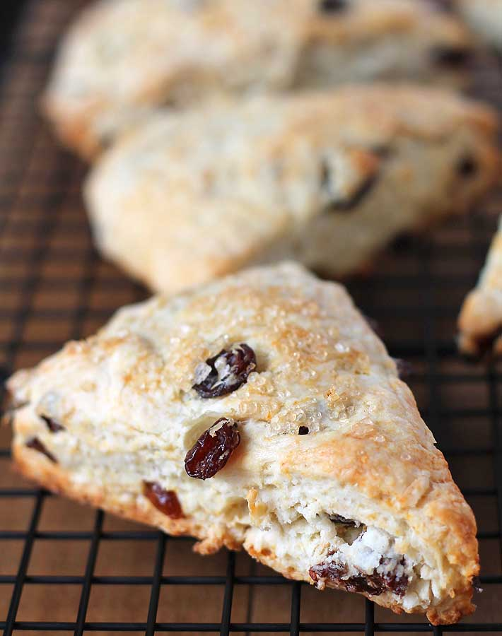 Up close shot of Coconut Raisin Vegan Scones showing the outer texture with turbinado sugar sprinkled on the top.