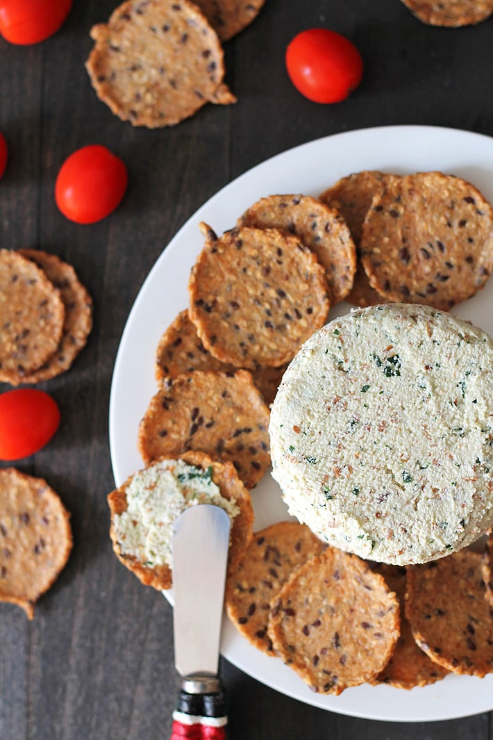This garlic herb vegan almond cheese spread is bursting with flavour and can be used in so many ways. It's great on crackers, sandwiches, as a veggie dip, and more! #vegancheese #veganalmondcheese #almondcheese #dairyfreecheese