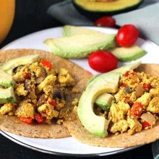 Close up shot of two Southwest Tofu Scramble Breakfast Tacos on a plate.