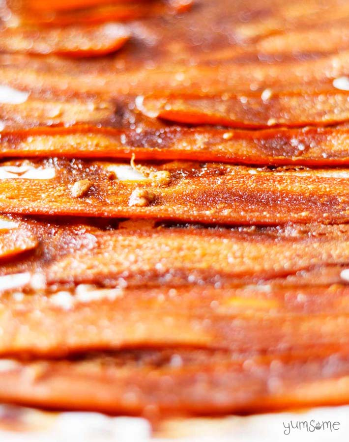 Vegan carrot bacon sitting on a tray.