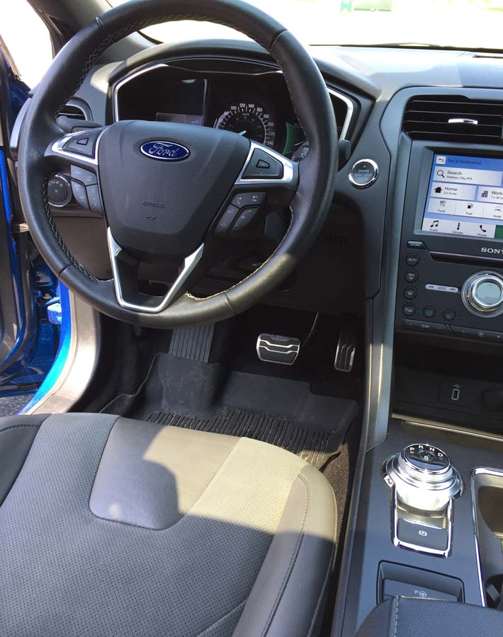 A view of the Ford Fusion Sport driver's seat, controls, and dashboard