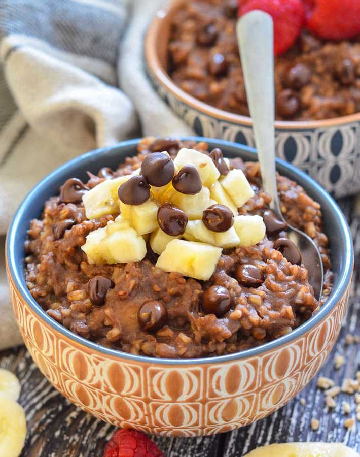 Easy Instant Pot Vegan Recipes - Chocolate Instant Pot Steel Cut Oats in a bowl with sliced bananas and chocolate chips on top for garnish.