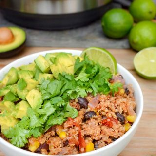 Easy Instant Pot Vegan Recipes - Instant Pot Mexican Quinoa Bowl on a wooden table with the Instant pot Pressure cooker in the backgroun and cut limes in the background.