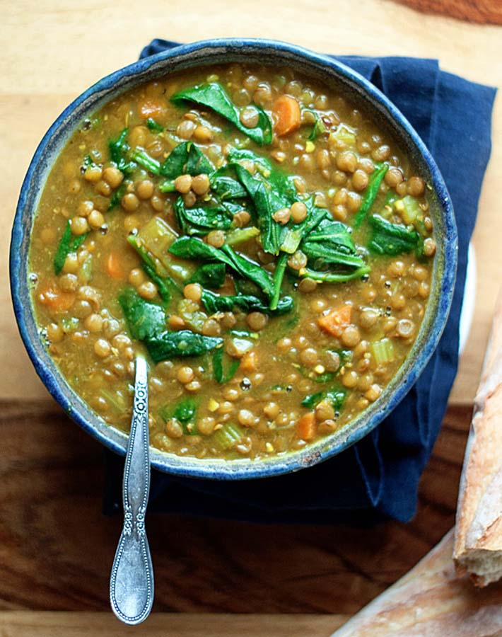 Easy Instant Post Vegan Recipes - Overhead shot of a bowl of Instant Pot Golden Lentil and Spinach Soup.
