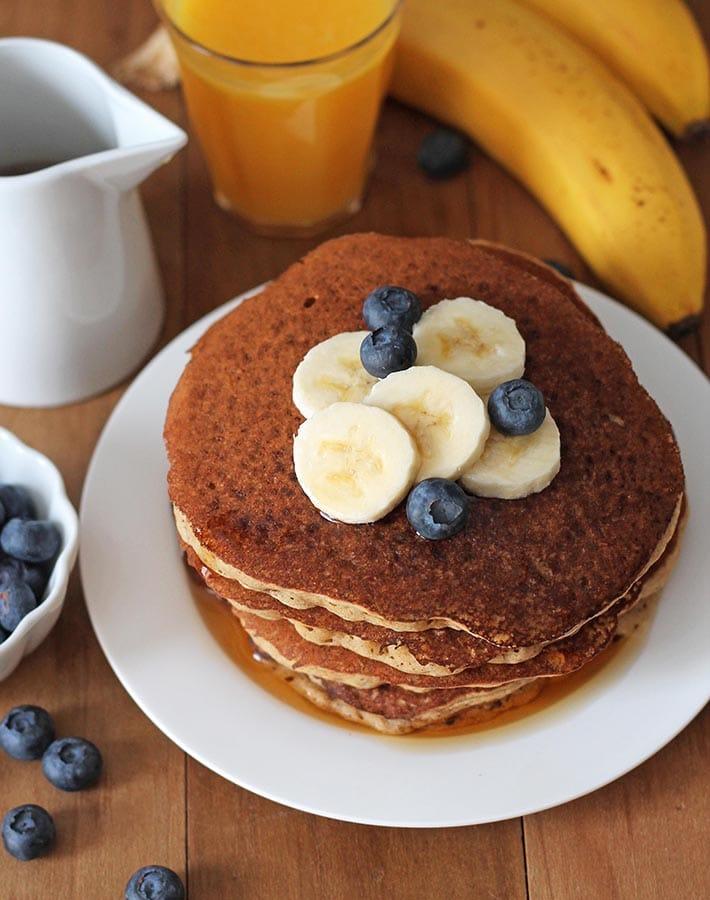 Ovehead shot of banana pancakes on a plate.