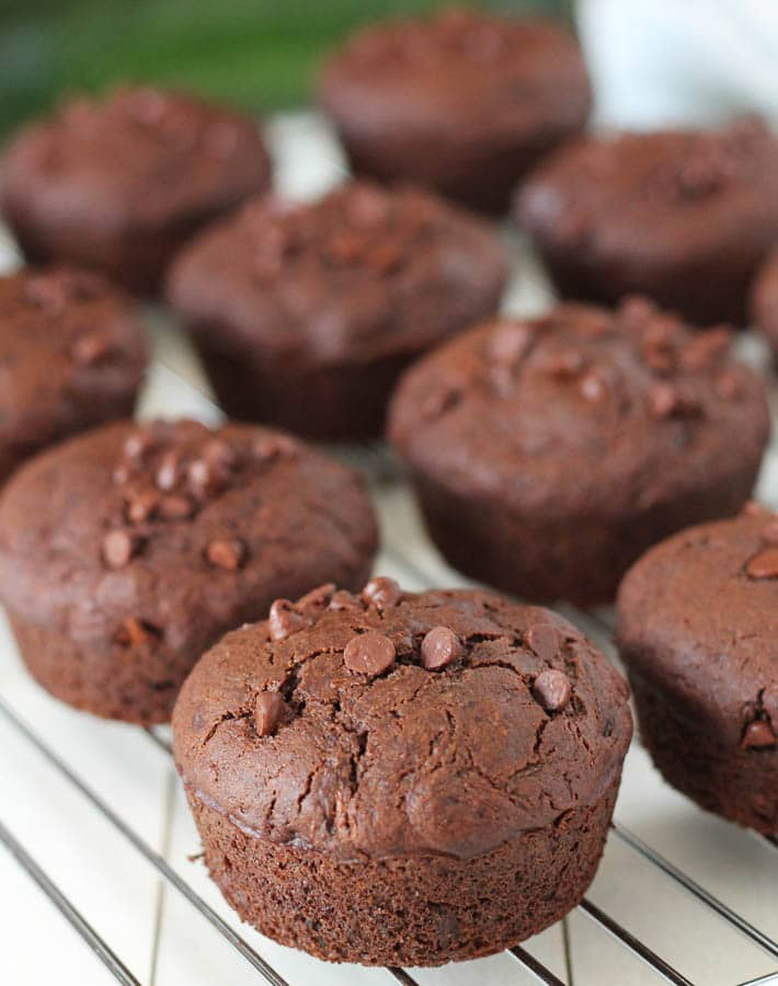 Vegan Gluten Free Chocolate Zucchini Muffins on a stainless steel cooling rack.