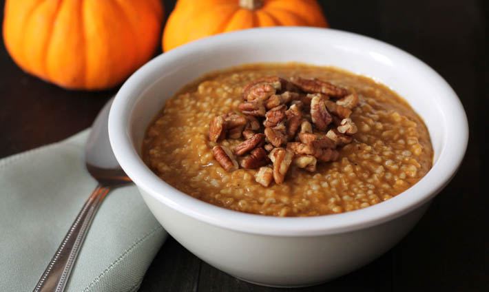 Pumpkin Steel Cut Oats in a bowl topped with chopped pecans.