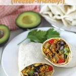 An easy recipe for vegan freezer breakfast burritos that include roasted potatoes, a delicious tofu scramble, and fresh toppings.
