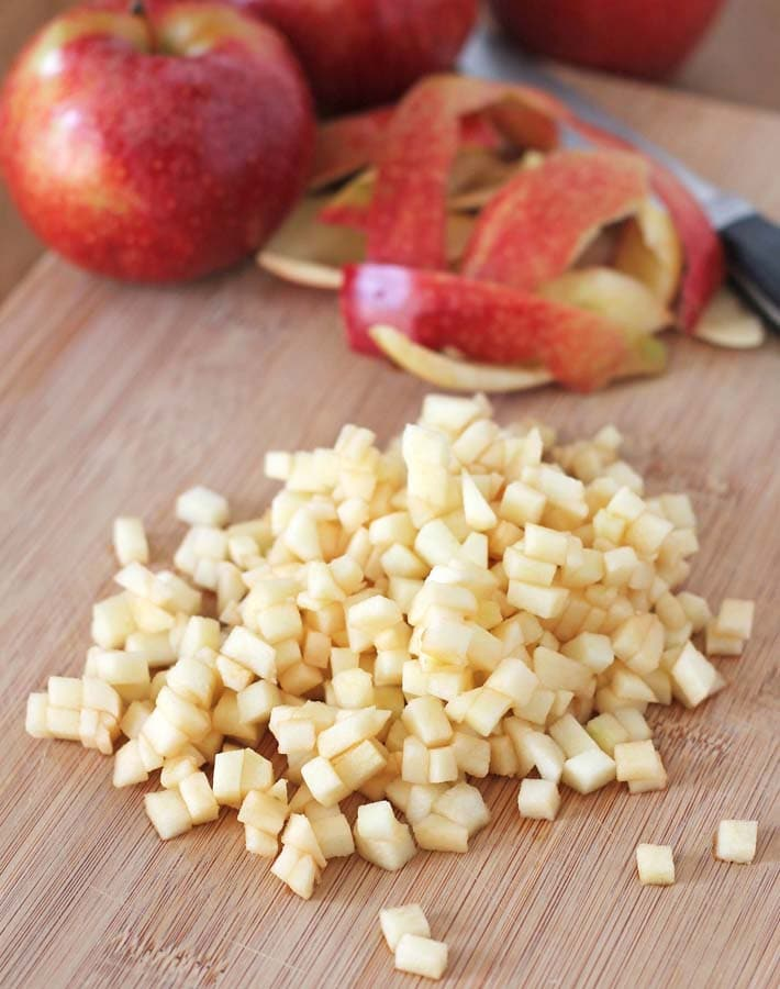 Chopped apples to add to the batter for Gluten Free Vegan Apple Muffins.