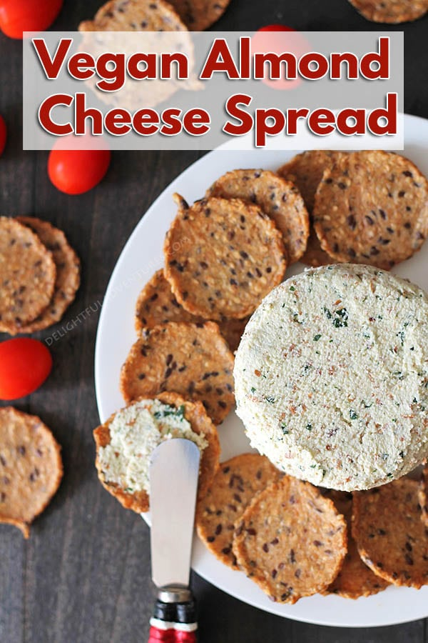This easy garlic herb vegan almond cheese spread is bursting with flavour and can be used in so many ways. It's great on crackers, sandwiches, as a veggie dip, and more!