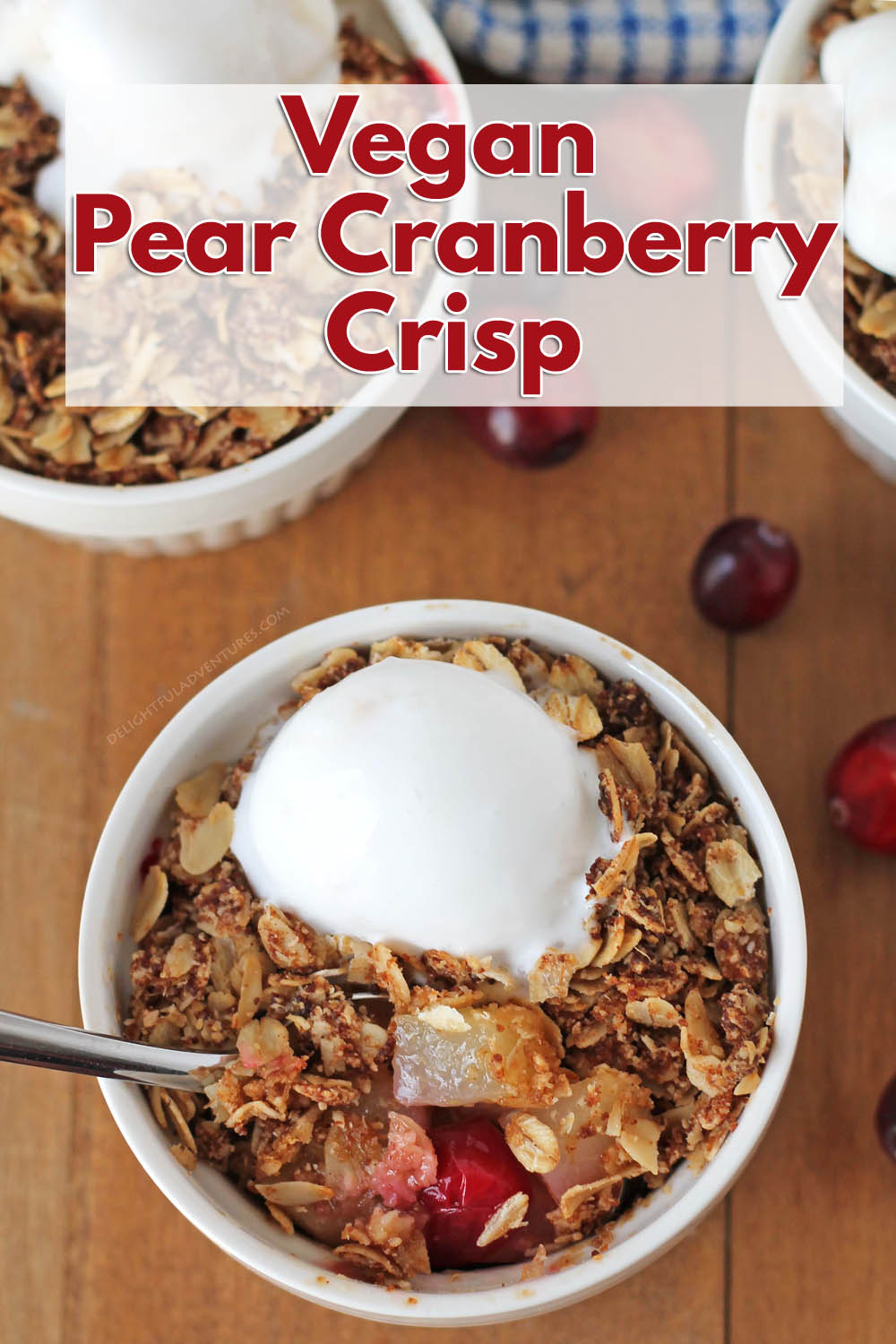 Sweet pears and tart cranberries combine to make this warm and flavorful pear cranberry crisp. It's a delicious & comforting fall dessert everyone will love! #delightfuladventures #pearcranberrycrisp #pearcrisp #veganpearrecipes