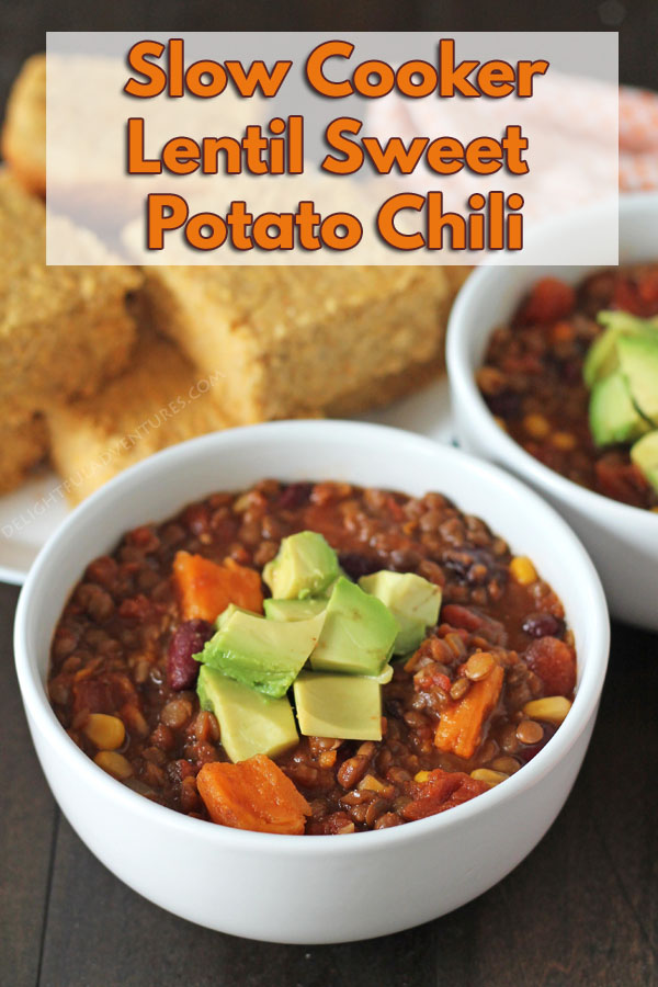 This vegan slow cooker chili is the perfect recipe to warm up with on cold days. Set it in the morning and your lentil sweet potato chili will be ready and waiting in the evening! #delightfuladventures #lentilchili #veganchili #slowcookerchili #veganslowcookerrecipe #sweetpotatochili