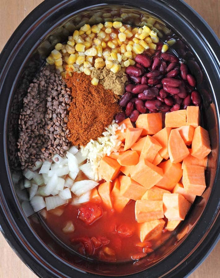 The ingredients for Lentil Sweet Potato Chili in a slow cooker before it gets cooked.