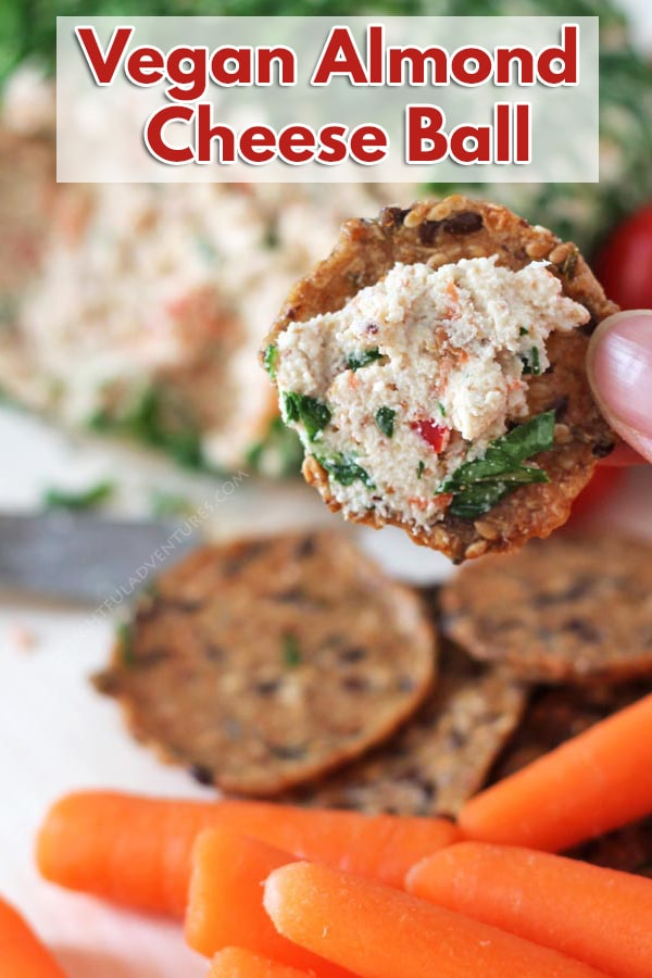 A cheesy vegan almond cheese makes up the base for this savoury, delicious vegan vegetable almond cheese ball that's great for snacking on or for parties.