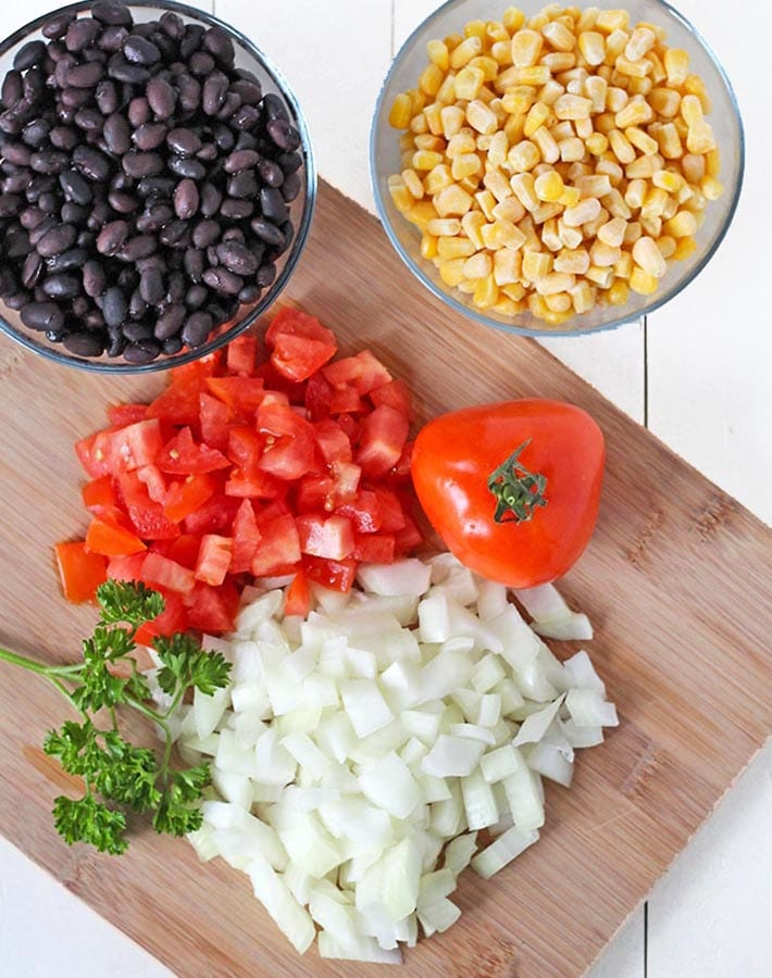 Overhead picture of some of the ingredients needed for Taco Rice Bowls.