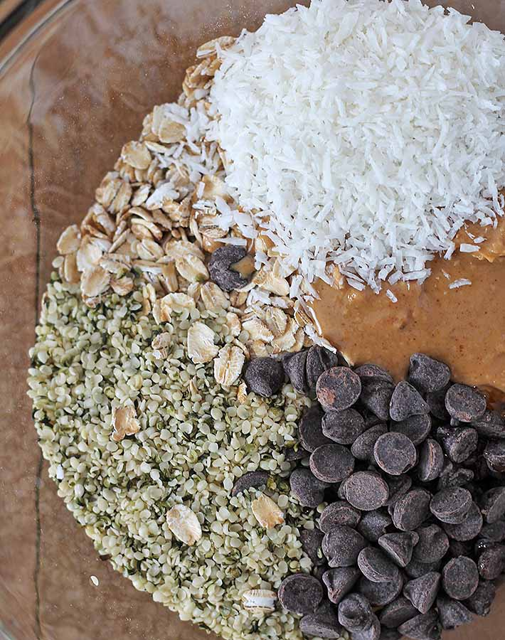 An overhead shot of the ingredients for No Bake Peanut Butter Coconut Balls in a glass bowl.