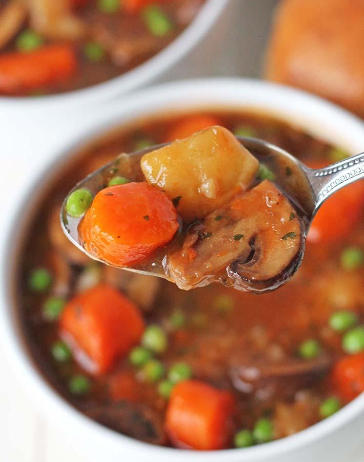 A closeup shot of a spoonful of mushroom stew.