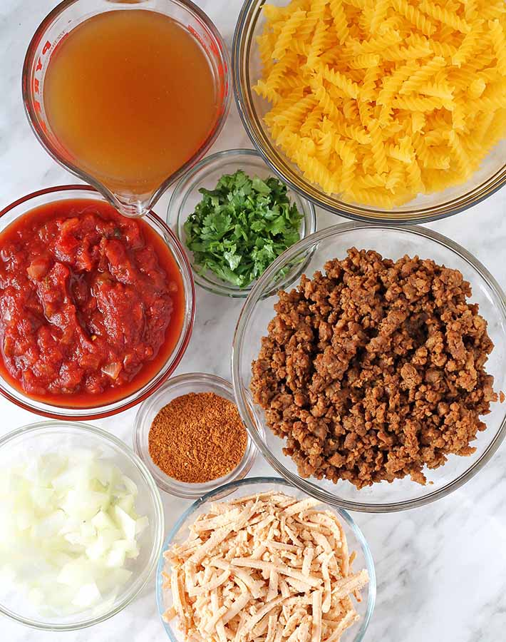 Overhead shot of all the ingredients needed to make One Pot Cheesy Taco Pasta.