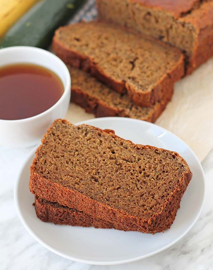 Two slices of Gluten-Free Banana Zucchini Bread on a white plate.