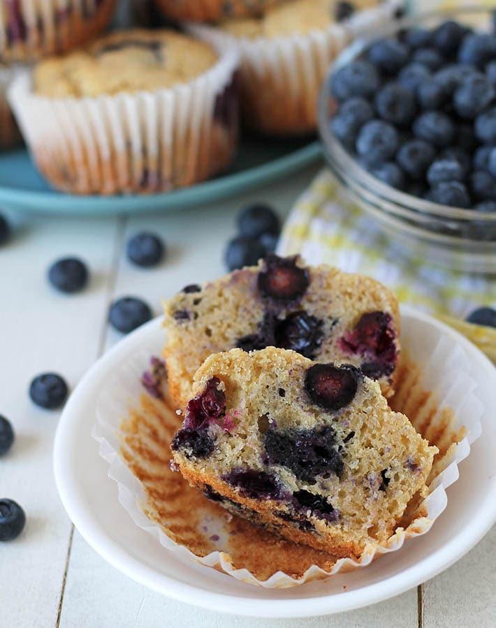 Vegan Gluten Free Blueberry Muffins split in half to show the inner texture.