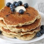 A stack of Gluten-Free Blueberry Pancakes on a plate.