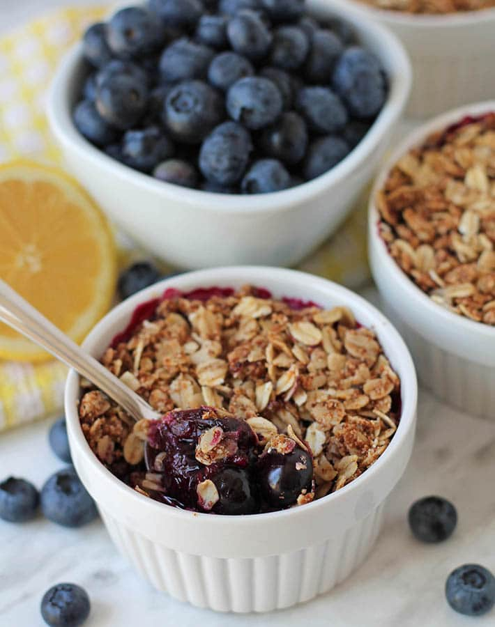 Gluten Free blueberry crisp in a white ramekin.