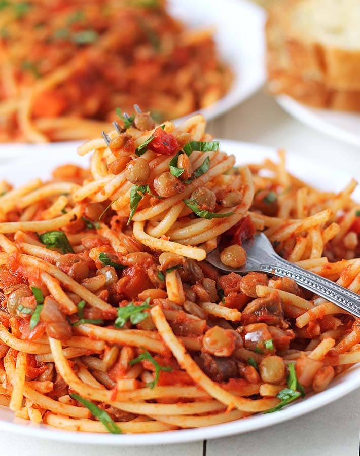 A plate of pasta with lentil spaghetti sauce.