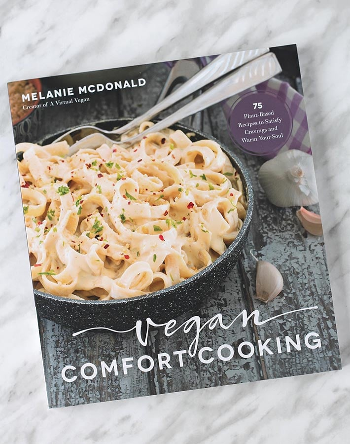 "The book ""Vegan Comfort Cooking"" on a table."