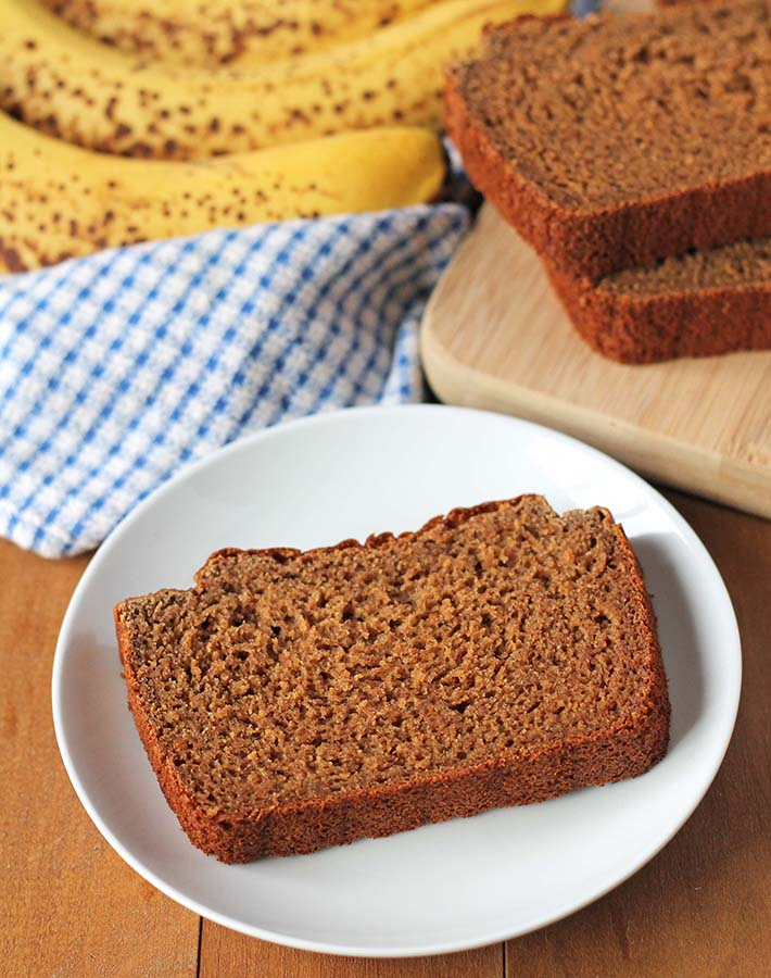 A slice of gluten dairy free banana bread on a white plate.