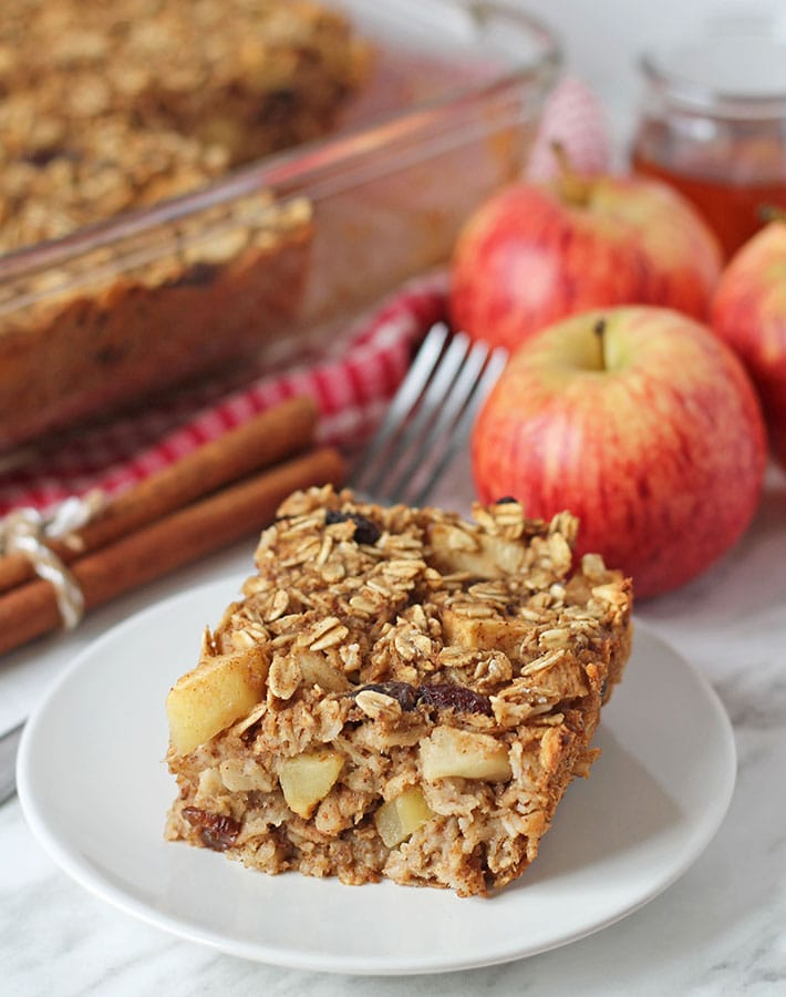 A square of apple baked vegan oatmeal on a plate.