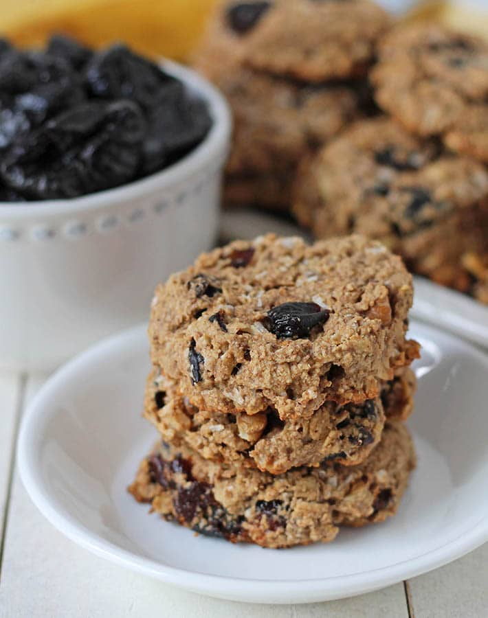 A stack of three gf breakfast cookies on a plate.