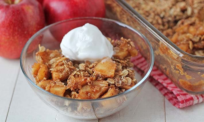 Close up shot of gluten free apple crisp in a bowl.
